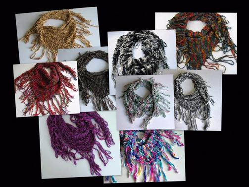 Scarves with fringe that are hand knit.